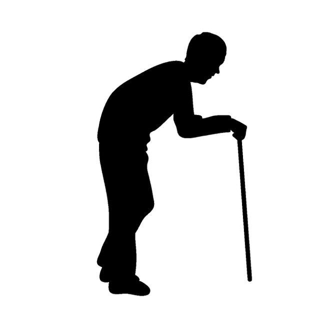 杖をつく老人のシルエット